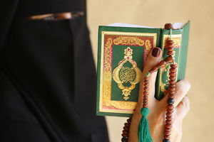 Muslim woman reading the Kuran