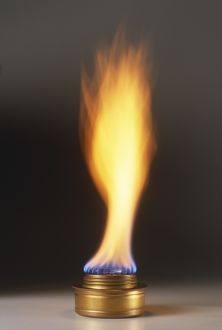 Natural gas burner and large orange and blue flame, close-up