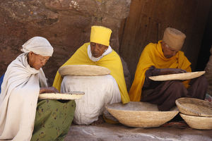 Nuns sorting wheat in Bet Maryam church courtyard