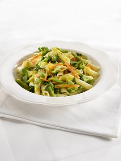Penne primavera, spring green vegetable pasta, close-up