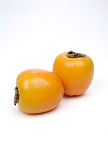 Persimmons on white background