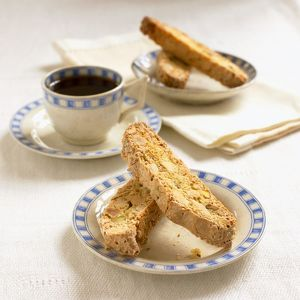 Plates of biscotti, cup of coffee, napkins