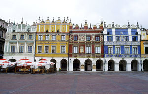 Poland, Krakow, colour facades of buildings and sidewalk cafe on Market Square