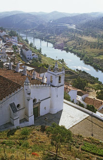Portugal, Mertola, view of Moorish-style church high above the Guadiana River