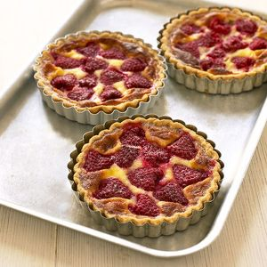 Three raspberry tarts