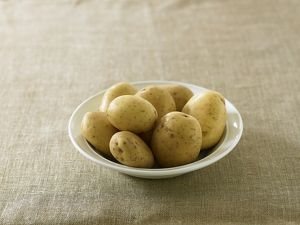 Raw potatoes in bowl