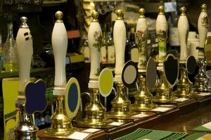 Row of beer taps in pub