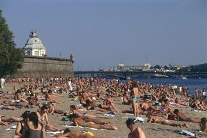 Russia, St Petersburg, the beach outside the Peter and Paul Fortress, full of people