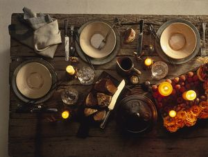 Rustic table set for candlelit dinner