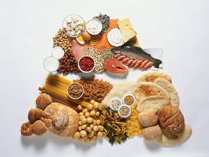Selection of foods high in protein and selection of foods high in carbohydrates