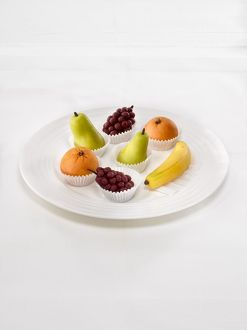 Selection of marzipan fruit arranged on a plate, close-up