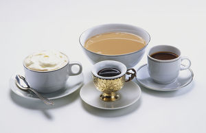 Servings of coffee, creamy, milky, espresso, Turkish, in variety of cups.
