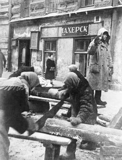 Siege of leningrad (sawing-wood for fuel).