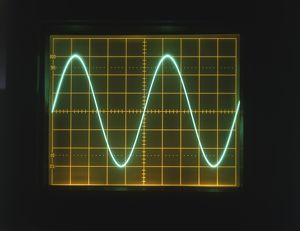 Sine wave displayed on oscilloscope screen