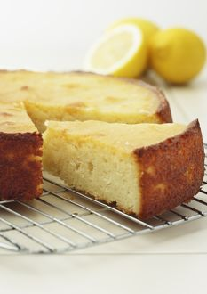 Slice of sticky lemon cake on cooling rack, close-up