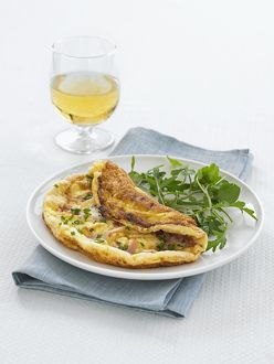Souffle omelette with rocket on plate