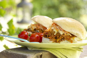 Southern slow-cooked pork with coleslaw in hamburger bun