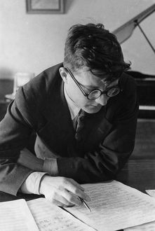 Soviet composer, dmitri shostakovich, working in his study, 1938