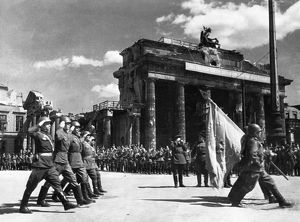 Soviet red army troops during a victory parade in front of the brandenburg gate in berlin