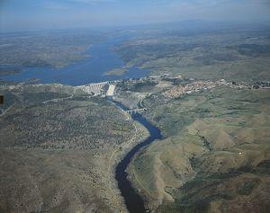 Spain, Extremadura, Aerial view of Alcantara dam on Tagus River