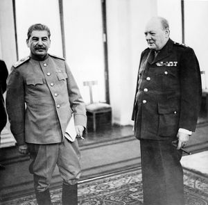 Stalin and churchill in the conference room of the livadia palace during the yalta conference