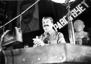Stalin speaks at the opening ceremonies celebating the first subway line, hall of columns