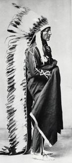 Standing Bear, Chief of the Sioux, wearing ceremonial robes and full length head-dress