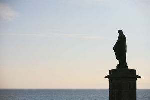 Statue of the Virgin Mary facing the Atlantic ocean