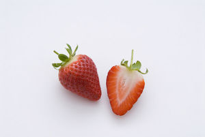 One strawberry and half strawberry, close-up