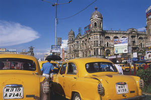 Street scene at New Market with Kolkata's distinctive taxis