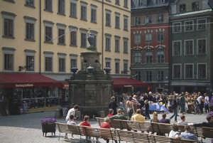 travel/sweden stockholm people seated stortorget square