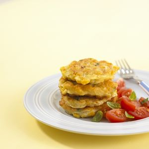 Sweetcorn fritters with cherry tomato salad, close-up