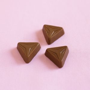 Three triangular shaped chocolates