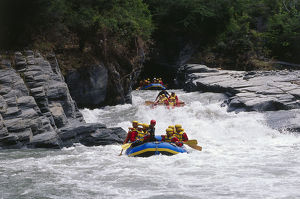 travel/white water rafting narrow gorges thundering rapids