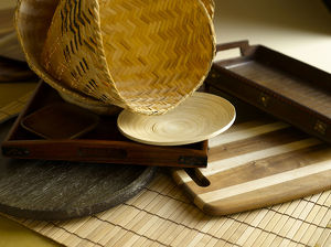 Wicker basket, serving dish, serving tray, plate and mat made from wood and bamboo