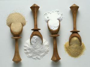 Four wooden spoons of ground yeast and gelatine, baking powder, and bicarbonate of soda