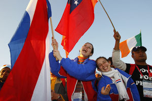 Young Catholics Wave Flags During World Youth Day