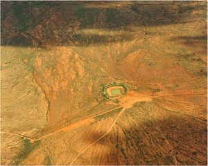 An Aerial view of the Australian outback, showing the vibrant colours of the Landscape
