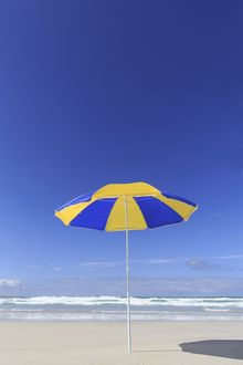 Blue and yellow beach umbrella
