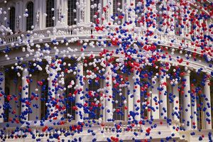 Detail of Capitol Building with red, white, and blue balloons
