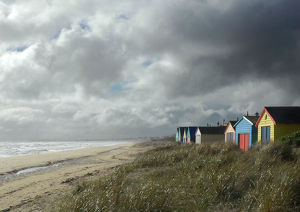 Clouds over beach with huts