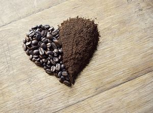 Coffee beans and grounds forming a heart shape