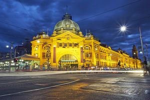 Facade of Flinders Street station illuminated at night