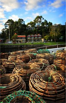 Lobster pots stacked on the Strahan wharf, west coastline of Tasmania.