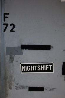 NIGHTSHIFT sign on a wall