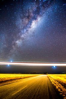 Stargazing; Lights of a low flying plane over an outback Australian road