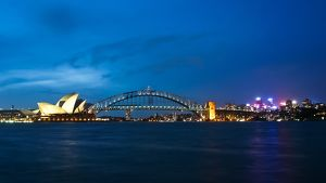 Sydney Harbour Bridge & Opera illuminated at dusk