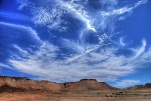 Wispy clouds over desert