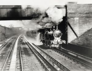 The London & North Western Railway locomotive Jeanie Deans picking up water at Bushey