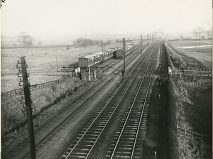 View north from Ely North Railway Junction, 1911. There is a a nest of three storage